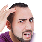 What Causes Baldness?